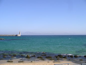 Looking past Tarifa harbour at North African coast