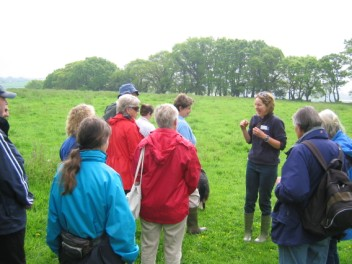 Katharine leading a group through farmland